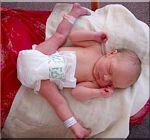 Typische houding bij een pasgeborene na een stuitligging